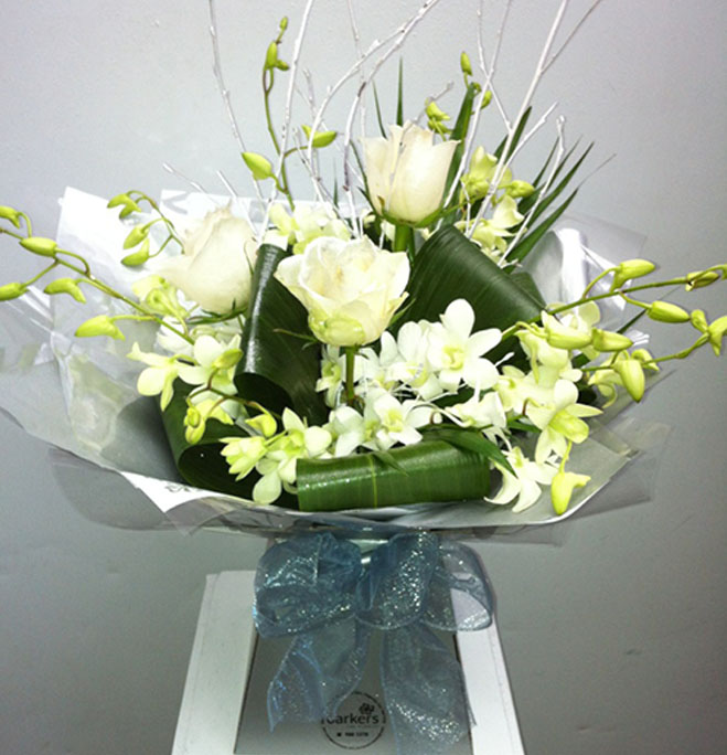 white rose and orchid hand tied