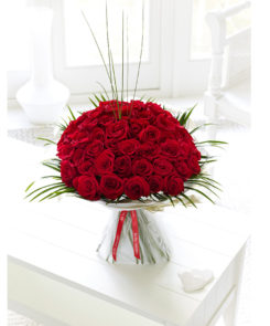 large red rose hand tied