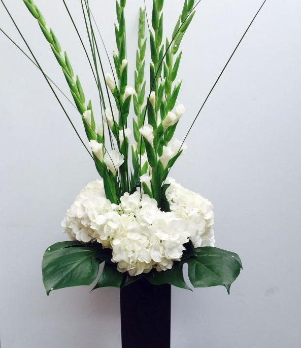 Hydrangea and Gladioli in a slim black vase